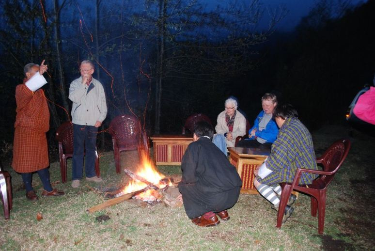 photo: Welcome party at Khaling, Einar and the Principal, Reidunn, Morten, Kuenga and Kelzang sitting around the fire.